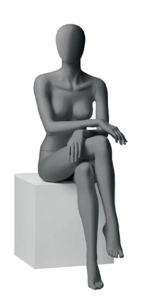 Dame sitzend mit abstraktem Kopf